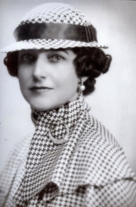 An Interior Decorator from the 1930s, Dorothy Draper, wears a houndstooth-patterned suit with a matching hat.
